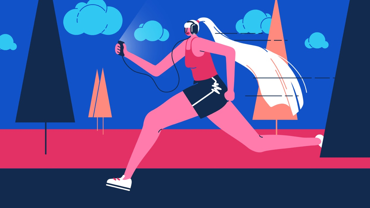 mixkit-woman-running-while-wearing-headphones-and-holding-a-mobile-phone-63-original-large.jpg
